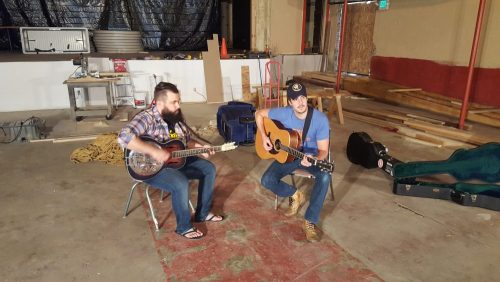 Anthony Olympia and Brent Rupard play a guitar song will visiting the Rialto Theater.