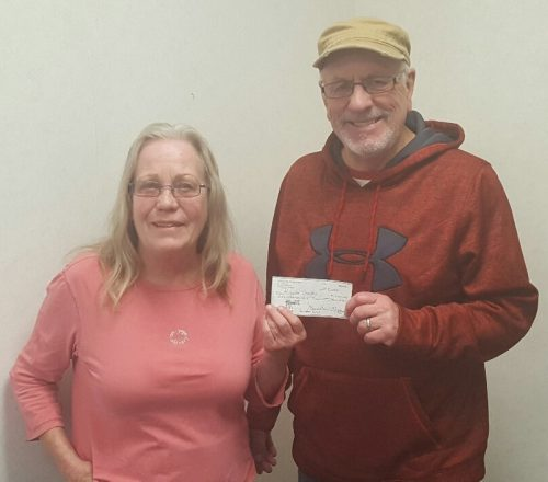 Board Member Donna Murphy presents check to ROn Hinkle